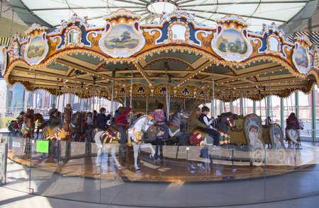 jane: BROOKLYN, NEW YORK - APRIL 24, 2014: Traditional fairground Jane s carousel in Brooklyn. It is historic and beautifully restored carousel build in 1922 a gift of Jane and David Walentas