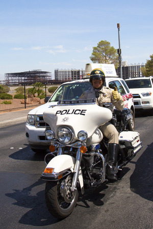 motorcycle officer: LAS VEGAS, NEVADA - MAY 9, 2014: Las Vegas Police Department officer on motorcycle on Las Vegas Strip. The Las Vegas Metropolitan Police Department is a joint city-county police force Editorial