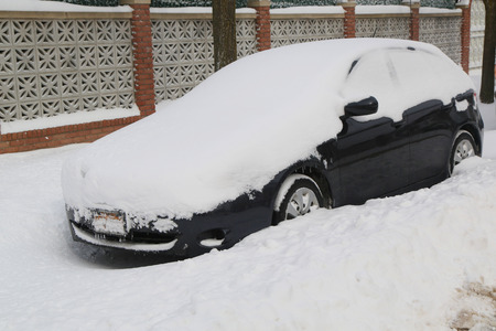 winter storm: BROOKLYN, NEW YORK - JANUARY 27, 2015: Car under snow in Brooklyn, NY after massive Winter Storm Juno strikes Northeast. Editorial