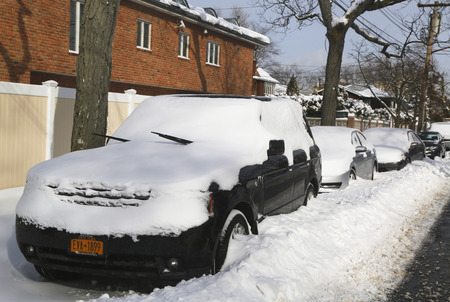 BROOKLYN, NEW YORK - JANUARY 27, 2015: Cars under snow in Brooklyn, NY after massive Winter Storm Juno strikes Northeast.