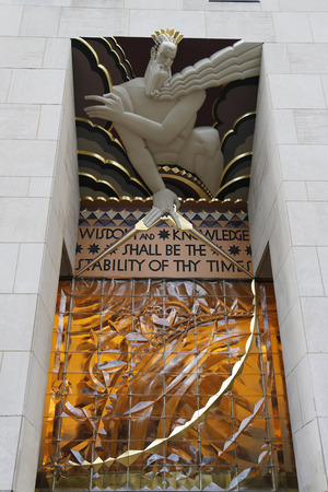 frieze: NEW YORK CITY - DECEMBER 18, 2014: Wisdom, an art deco frieze by Lee Lawrie over the entrance of GE Building at Rockefeller plaza