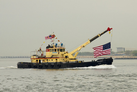 best protection: NEW YORK - MAY 21: U.S. Army Corps Of Engineers ship Hayward during parade of ships at Fleet Week 2014 on May 21, 2014 in New York Harbor. It is the New York District Drift Collection Vessel