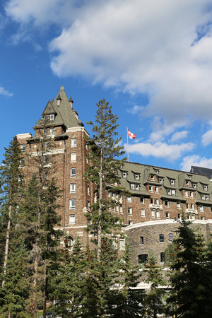 BANFF, CANADA - JULY 26, 2014: Banff Springs Hotel in the Canadian Rockies. The Banff Springs Hotel was built during the 19th century in Scottish Baronial style