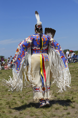 pow wow: NEW YORK - JUNE 8, 2014: Unidentified female Native American dancer wears traditional Pow Wow dress during the NYC Pow Wow in Brooklyn Editorial
