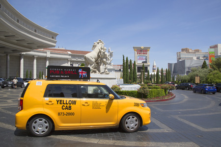las vegas  nevada: LAS VEGAS, NEVADA - MAY 9, 2014: Las Vegas Yellow Cab at the front of Caesars Palace Las Vegas Hotel & Casino.