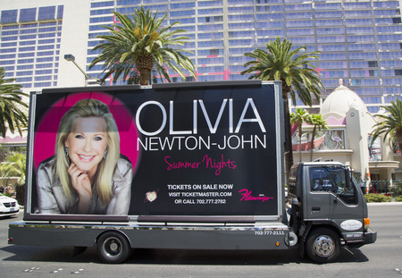 LAS VEGAS, NEVADA  - MAY 9, 2014: Billboard truck on Las Vegas Strip in Las Vegas Редакционное
