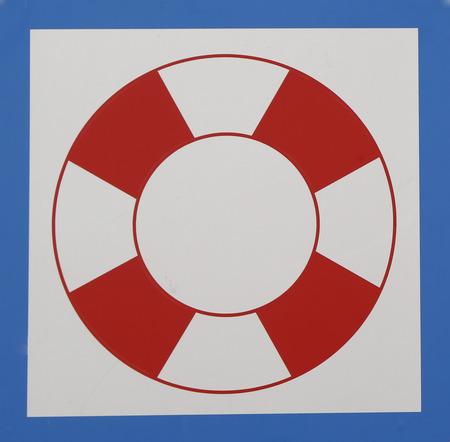 Lifebuoy sign at a beach Imagens