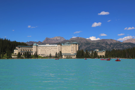 louise: LAKE LOUISE, CANADA - JULY 27, 2014: View of the famous Fairmont Chateau Lake Louise Hotel. Lake Louise is the second most-visited destination in the Banff National Park Editorial