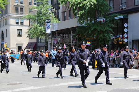 sexual orientation: NEW YORK - JUNE 29, 2014: NYPD members at LGBT Pride Parade in New York City. LGBT pride march takes place during pride week and is the culmination of week long festivities Editorial