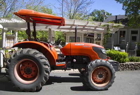 NAPA VALLEY, CA - APRIL 14, 2014: Red Kubota M8540 tractor at the winery in Napa Valley