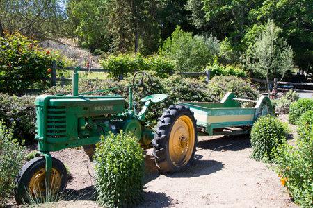 john deere: NAPA VALLEY, CA - APRIL 14, 2014: Vintage John Deere tractor at the winery in Napa Valley Editorial