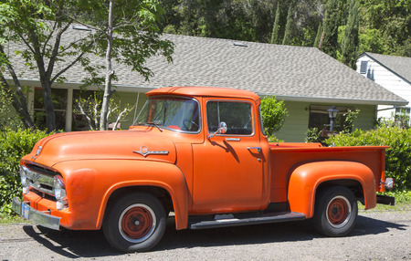 brawny: NAPA VALLEY, CA - APRIL 14, 2014: 1956 Ford F-100 Custom Cab Pickup Truck in Napa Valley Editorial