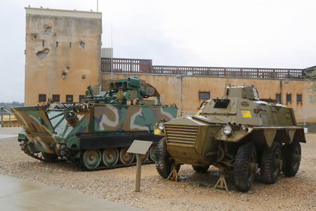 improved: LATRUN, ISRAEL - NOVEMBER 27, 2014: American made M901 Improved TOW Vehicle (left) and  FV603 Saracen six-wheeled armored personnel carrier (right) on display at Yad La-Shiryon Armored Corps Museum Editorial