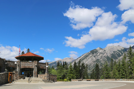 basin mountain: BANFF, CANADA - JULY 29, 2014: Cave and Basin National Historical Site of Canada in the Town of Banff. It is the site of natural thermal mineral springs in Banff National Park. Editorial