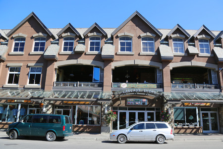 cascade range: BANFF, CANADA - JULY 29, 2014: Cascade Shops at the famous Banff Avenue in Banff National Park. Banff is a resort town and one of Canada s most popular tourist destinations Editorial