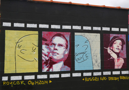 NEW YORK - JULY 24, 2014: Mural art in Astoria section of Queens. A mural is any piece of artwork painted or applied directly on a wall, ceiling or other large permanent surface