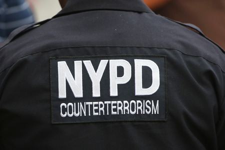 police unit: NEW YORK - AUGUST 30, 2014: NYPD counter terrorism unit officer providing security at National Tennis Center during US Open 2014 in New York