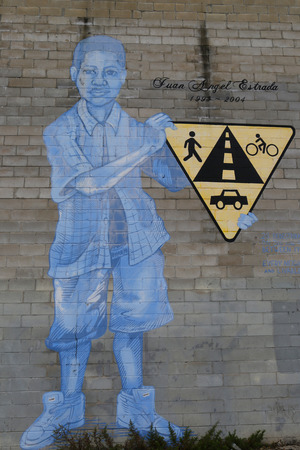 not painted: NEW YORK - NOVEMBER 13, 2014:Mural Not One More Death in Park Slope section of Brooklyn. A mural is any piece of artwork painted or applied directly on a wall, ceiling or other large permanent surface Editorial