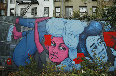 NEW YORK - NOVEMBER 18, 2014: Mural art at Houston Avenue in Soho. A mural is any piece of artwork painted or applied directly on a wall, ceiling or other large permanent surface