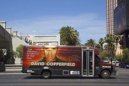 LAS VEGAS, NEVADA - MAY 10, 2014: Airline shuttle bus with David Copperfield advertisement on Las Vegas Strip in Las Vegas