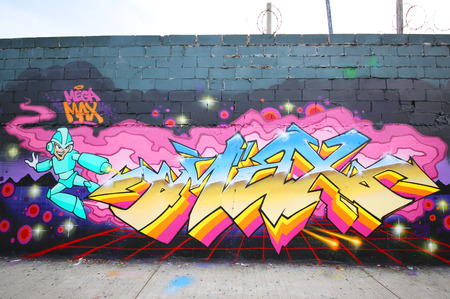 NEW YORK - DECEMBER 4, 2014: Graffiti art at East Williamsburg in Brooklyn. Outdoor art gallery known as the Bushwick Collective has most diverse collection of street art in Brooklyn