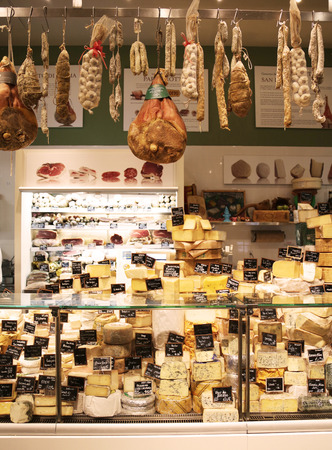 longaniza: NEW YORK - JUNE 29, 2014: Cured meat, salami and artisan cheeses in Italian store in New York. Little Italy is a neighborhood in lower Manhattan once known for its large population of Italians