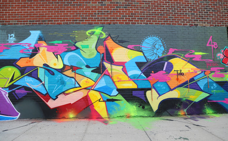 NEW YORK - JULY 24, 2014: Graffiti art at East Williamsburg in Brooklyn. Outdoor art gallery known as the Bushwick Collective has most diverse collection of street art in Brooklyn Editorial