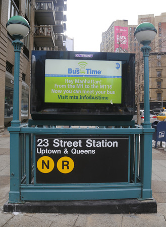 subway entrance: NEW YORK - FEBRUARY 19, 2015: Subway entrance at 23rd Street in NYC. Station has free Wi-Fi available. Owned by the NYC Transit Authority, the subway system has 469 stations in operation