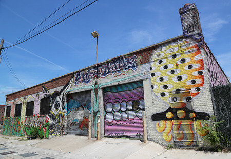 NEW YORK - JUNE 1, 2014: Mural art at East Williamsburg in Brooklyn. Outdoor art gallery known as the Bushwick Collective has most diverse collection of street art in Brooklyn Reklamní fotografie - 36839950