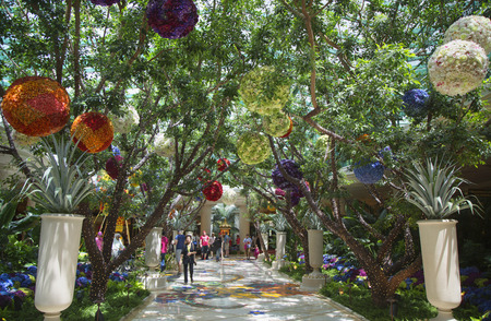 steve: LAS VEGAS, NEVADA - MAY 11, 2014 : Floral sculptures in the atrium of Wynn Hotel and Casino in Las Vegas. The US$2.7 billion resort is named after casino developer Steve Wynn