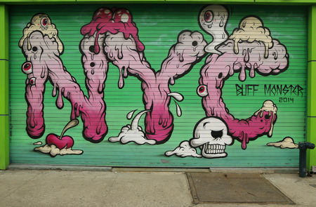 buff: NEW YORK - FEBRUARY 26, 2015: Mural art by Buff Monster in Little Italy in Manhattan. A mural is any piece of artwork painted or applied directly on a wall, ceiling or other large permanent surface