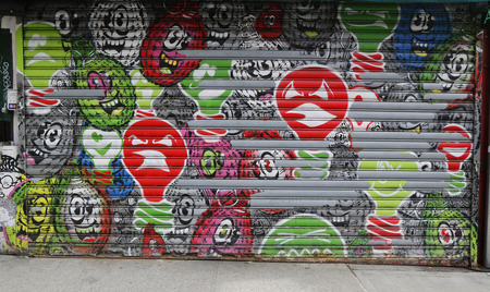 spud: NEW YORK - FEBRUARY 26, 2015: Mural art Explosive illumination by Spud x Meres One in Little Italy
