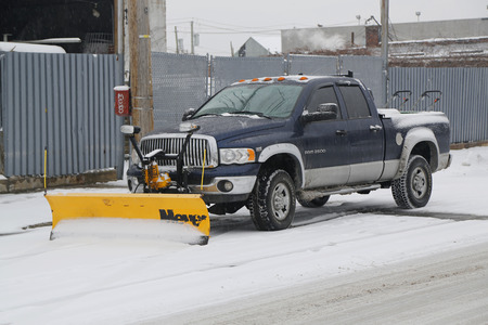 BROOKLYN, NEW YORK - MARCH 1, 2015: Snow plow truck in Brooklyn, NY ready to clean streets after massive Winter Storm Sparta strikes Northeast Editorial