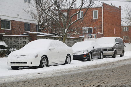 BROOKLYN, NEW YORK - MARCH 1, 2015: Cars under snow in Brooklyn, NY during massive Winter Storm Sparta strikes Northeast