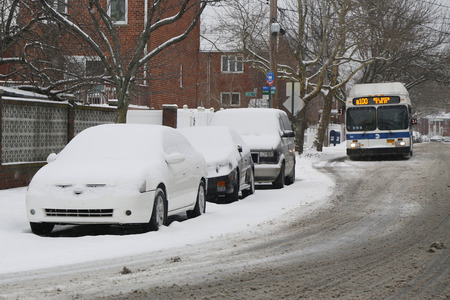 inconvenient: BROOKLYN, NEW YORK - MARCH 1, 2015: Cars under snow in Brooklyn, NY during massive Winter Storm Sparta strikes Northeast
