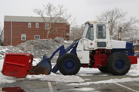 inconvenient: BROOKLYN, NEW YORK - MARCH 3, 2015: Tractor Snow Plow in Brooklyn, NY during record breaking winter