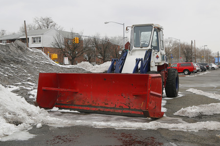 BROOKLYN, NEW YORK - MARCH 3, 2015: Tractor Snow Plow in Brooklyn, NY during record breaking winter
