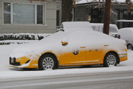 inconvenient: BROOKLYN, NEW YORK - MARCH 5, 2015: New York Yellow taxi under snow in Brooklyn, NY during massive Winter Storm Thor