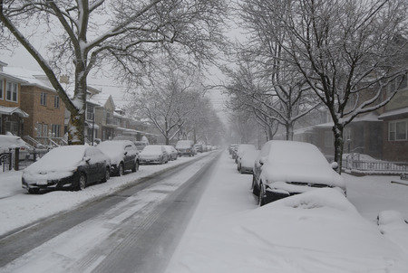 inconvenient: BROOKLYN, NEW YORK - MARCH 5, 2015: Cars under snow in Brooklyn, NY during massive Winter Storm Thor