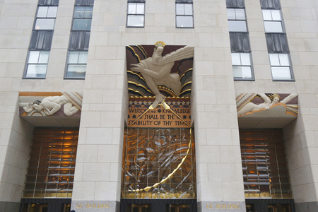 frieze: NEW YORK - FEBRUARY 26, 2015: Wisdom, an art deco frieze by Lee Lawrie over the entrance of GE Building at Rockefeller plaza