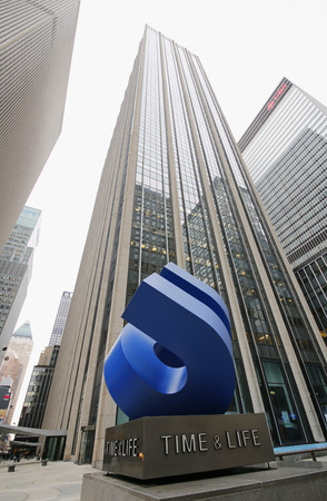the publisher: NEW YORK - FEBRUARY 26, 2015: Time and Life statue in the front of famous Time and Life building in Manhattan. Time Inc is the publisher of Time, Life, Sports Illustrated, Fortune magazines