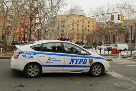 police force: NEW YORK - FEBRUARY 26, 2015: NYPD traffic control vehicle in Lower Manhattan. The New York Police Department, established in 1845, is the largest police force in USA