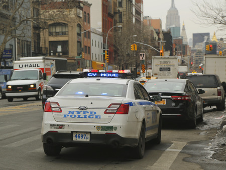 new world order: NEW YORK - FEBRUARY 26, 2015: NYPD car providing security at Little Italy. New York Police Department, established in 1845, is the largest police force in USA Editorial