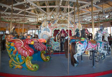 BROOKLYN, NEW YORK - MAY 17, 2014: Horses on a traditional fairground B&B carousel at historic Coney Island Boardwalk in Brooklyn