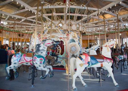 bb: BROOKLYN, NEW YORK - MAY 17, 2014: Horses on a traditional fairground B&B carousel at historic Coney Island Boardwalk in Brooklyn