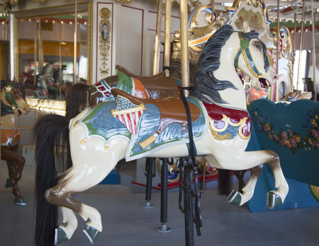 bb: BROOKLYN, NEW YORK - MAY 17, 2014: Horses on a traditional fairground B&B carousel at historic Coney Island Boardwalk in Brooklyn