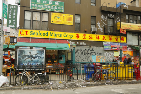 enclave: NEW YORK - FEBRUARY 26, 2015: Street scene in Chinatown in New York. Chinatown, Manhattan is a neighborhood in Manhattan that is home to the largest enclave of Chinese people in the Western Hemisphere