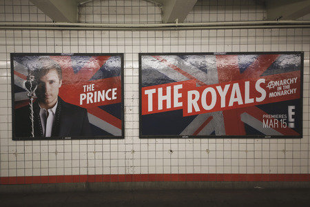 royals: NEW YORK - FEBRUARY 26, 2015: The Royals TV series billboard in New York s subway. The Royals is an upcoming television drama series that will premiere on E! on March 15, 2015