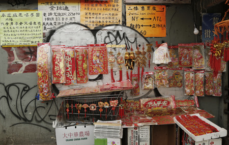 best location: NEW YORK - FEBRUARY 26, 2015: Chinese souvenirs on display in Chinatown. Chinatown is a neighborhood in Manhattan that is home to the largest enclave of Chinese people in the Western Hemisphere