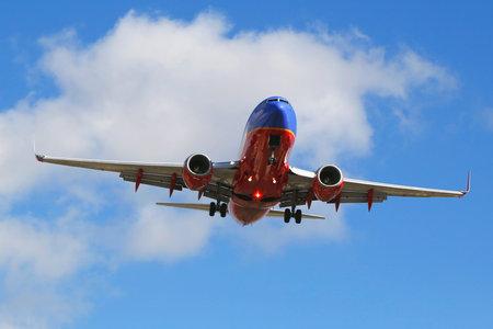 SAN DIEGO, CALIFORNIA - SEPTEMBER 27, 2014: Southwest Airlines jet descending for landing San Diego International Airport.